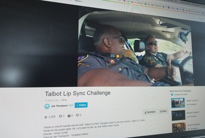 "Two deputies with the Talbot County Sheriff's Department ""rap"" while they ride in a patrol car during a lip sync video."