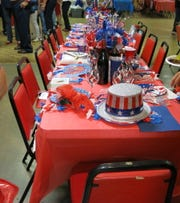 Festive table at Krewe Elders Star Spangled Night Coronation XXI.
