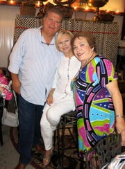 Kilgore, Texas, residents Carl and Coleen Clowers with Rachel Brian, who celebrated Birthday 75 with a party a the Clowers' Barn.