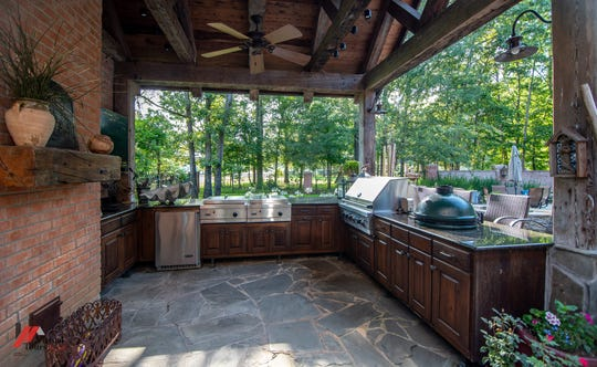 Entertaining poolside is made easy thanks to the recently added $100,000 outdoor kitchen.