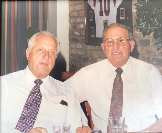 Former L.A. Dodgers manager Tommy Lasorda, left, visits with former Loyola baseball coach Frank Cicero at a past event at Dominic's Restaurant in Shreveport. Cicero passed away Sunday in Shreveport.