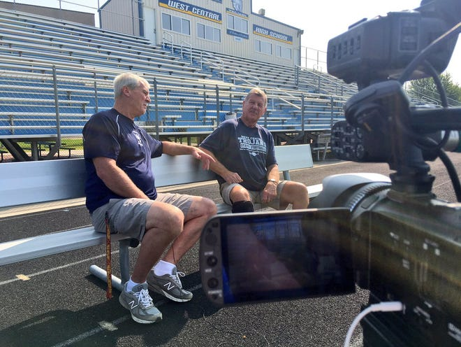 Current West Central coach Kent Mueller (left) and former West Central coach Jim Uttecht sit down for an interview at West Central High School in Hartford, S.D. on Saturday, August 25, 2018.