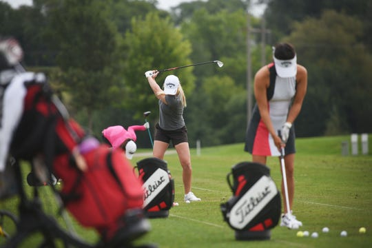 Stephanie Meadow, center, and Stephanie Kono, right, golf at Willow Run Golf Course after the LPGA Symetra Tour media briefing Monday, Aug 27, in Sioux Falls.