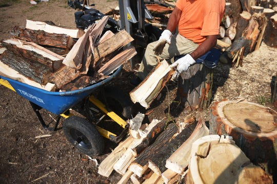 Inmates chop wood at the South Dakota State Penitentiary Friday, Aug 17, in Sioux Falls. Mary Montoya, South Dakota State Penitentiary Chapel volunteer, said they are experiencing a shortage of donated wood. It is becoming problematic for inmates who participate in sweat lodge ceremonies.