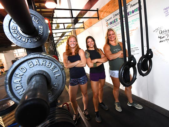 Alex Clark, Jessie Purcell and Kelly Lum recently purchased CrossFit Staunton on Greenville Avenue. They are photographed together within the fitness studio they now own on Monday, August 27, 2018.