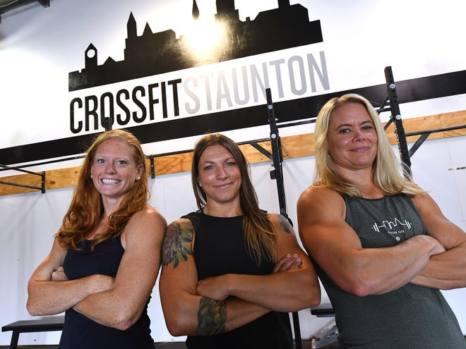 Alex Clark, Jessie Purcell and Kelly Lum stand together inside CrossFit Staunton, which they now own together, on Monday, August 27, 2018.