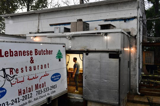 A man is seen at Lebanese Butchers Slaughterhouse as people get meat to celebrate Eid al-Adha on Aug. 21 in Warrenton, Va.