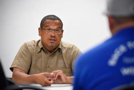 Minnesota attorney general candidate U.S. Rep. Keith Ellison talks with workers during a campaign stop Monday, Aug. 27, at the St. Cloud Machinist Local Lodge 623.