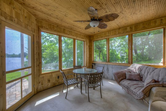 A screened porch is meant for enjoying the lake bug-free into the evening hours.