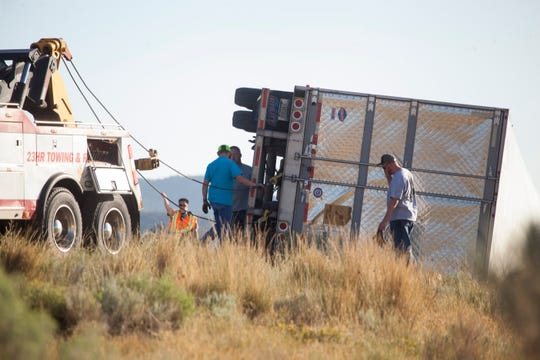 Crews clean up after a semi-truck transporting bags of flour overturned on I-15 north of Enoch Sunday, Aug. 26, 2018.