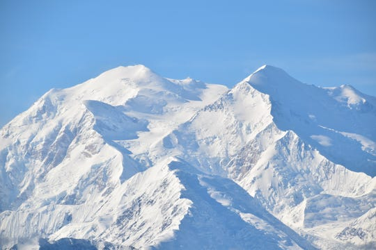"""Alaska's snow-capped Dinali """"the Great One,"""" formerly Mount McKinley, on a rare day when the cloud part."""
