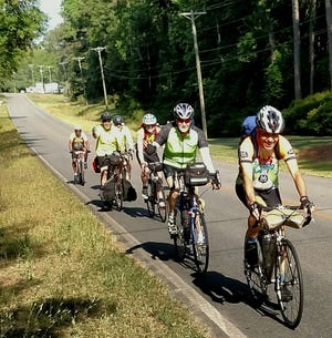 """Dennis  Wirth, 80 years old, leading the """"Vagabonds"""" bicycle """"pelethon."""""""