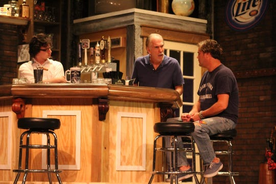 "Brendan Wenger (Adam, left), Steve Budkiewicz (Ray, center) are in disbelief when caught up in the tale Jason Miles (Palmer, right) spins about when he found one of the 9/11 hijackers' passport lying on the street three blocks from the World Trade Center. All are in Vero Beach Theatre Guild's ""Yankee Tavern."""