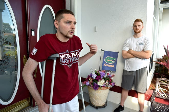 Dalton Kent, 22, (left) stands with his brother Garrett Kent, 23, at their parent's home in Port St. Lucie on Monday, Aug. 27, 2018, while talking about being shot during a video game tournament in Jacksonville. Dalton Kent, a Treasure Coast High School teacher, was hit when a bullet ricocheted off his ankle during the Madden football tournament Sunday, Aug. 26, 2018, at the Jacksonville Landing Complex.