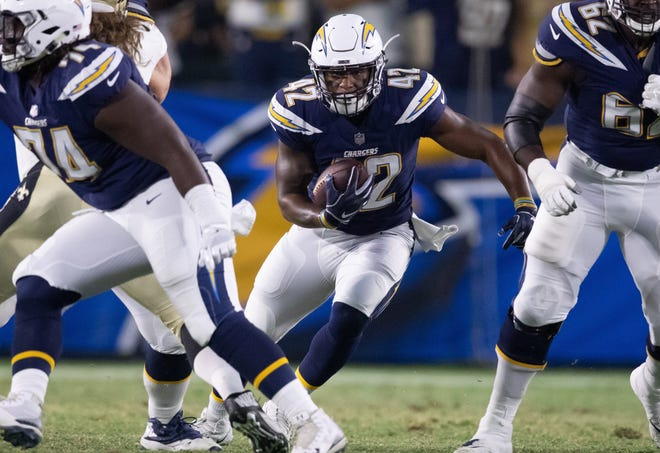 Oxnard High graduate Terrell Watson hits the hole during the Chargers' preseason game against the Saints on Saturday.