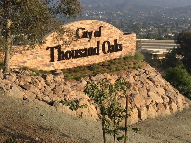 "A large new City of Thousand Oaks ""gateway"" sign has been installed high above Highway 101 on the city's west end, greeting motorists driving up the Conejo Grade from Camarillo."