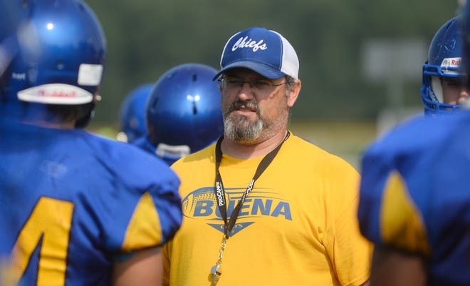 Buena High School football coach Jonathan Caputo speaks with the team during practice on Monday, August 27.