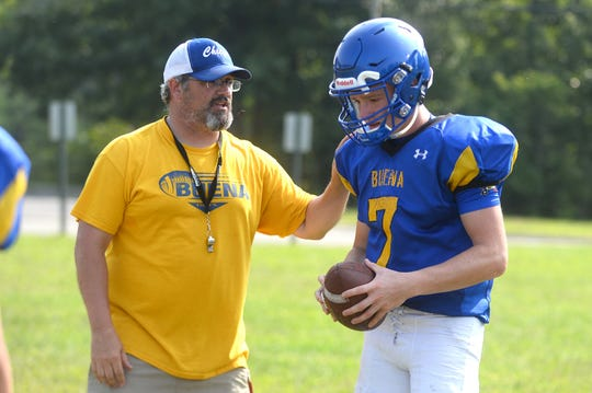 Buena High School football coach Jonathan Caputo speaks with Luke Santiago (QB) during practice on Monday, August 27.