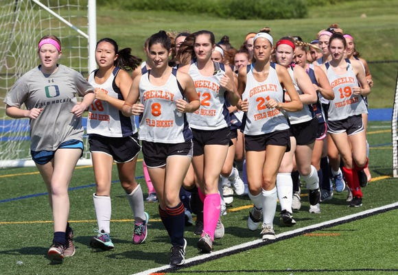 Horace Greeley field hockey players warm up before practice at Horace Greeley High School in Chappaqua Aug. 24, 2018.