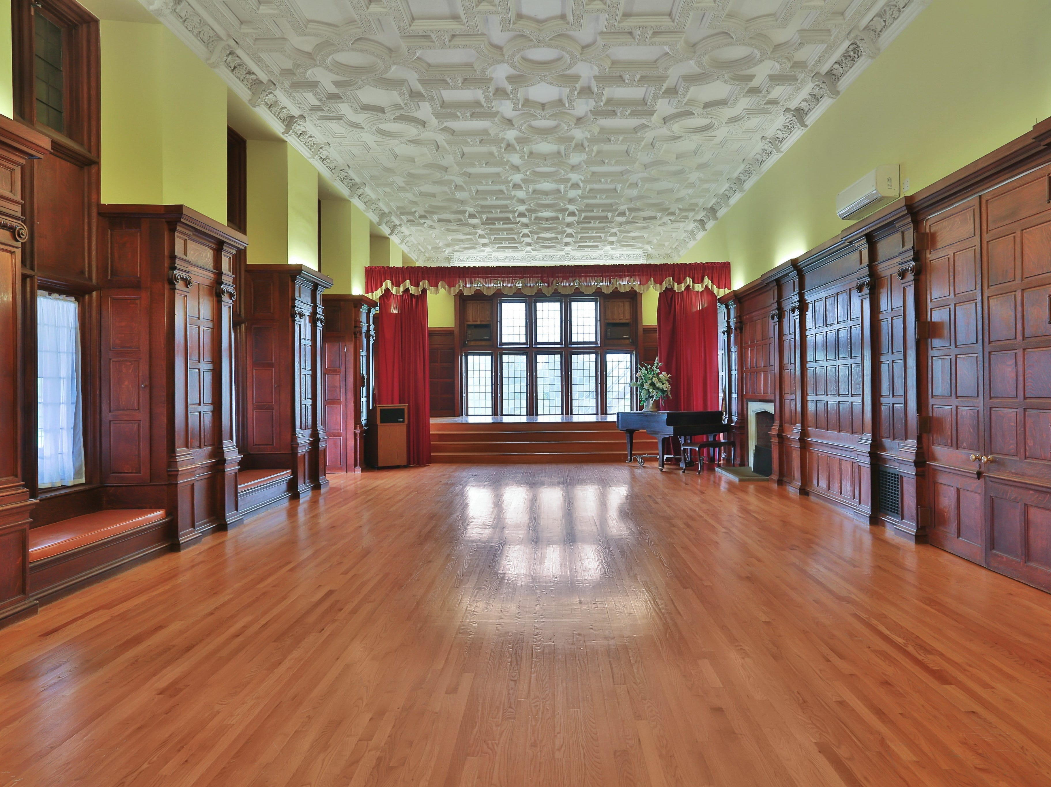The walls and floor are oak, while the ceiling is elaborately sculptured plaster.
