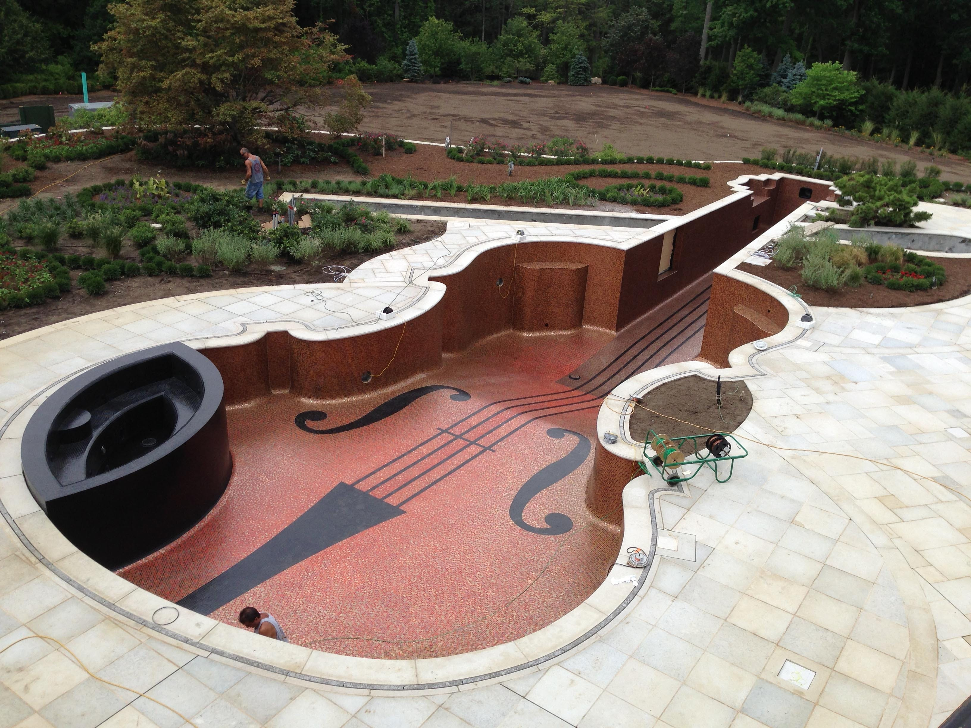 A unique violin-shaped pool was designed and built by Chris Cipriano of Mahwah, N.J.  Courtesy of Cipriano Landscape Design A unique violin-shaped pool was designed and built by Chris Cipriano, of Mahwah, N.J., -based Cipriano Landscape Design.