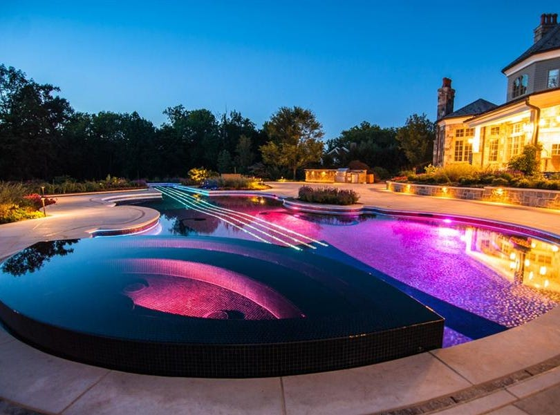 This pool, shaped like a rare Stradivarius violin, was created by Cipriano Landscape Designs. Included in the pool's design are the F holes, the strings, the base and a chin rest that is actually a spa.