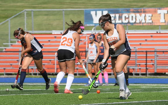 Horace Greeley field hockey players run a drill during practice at Horace Greeley High School in Chappaqua Aug. 24, 2018.