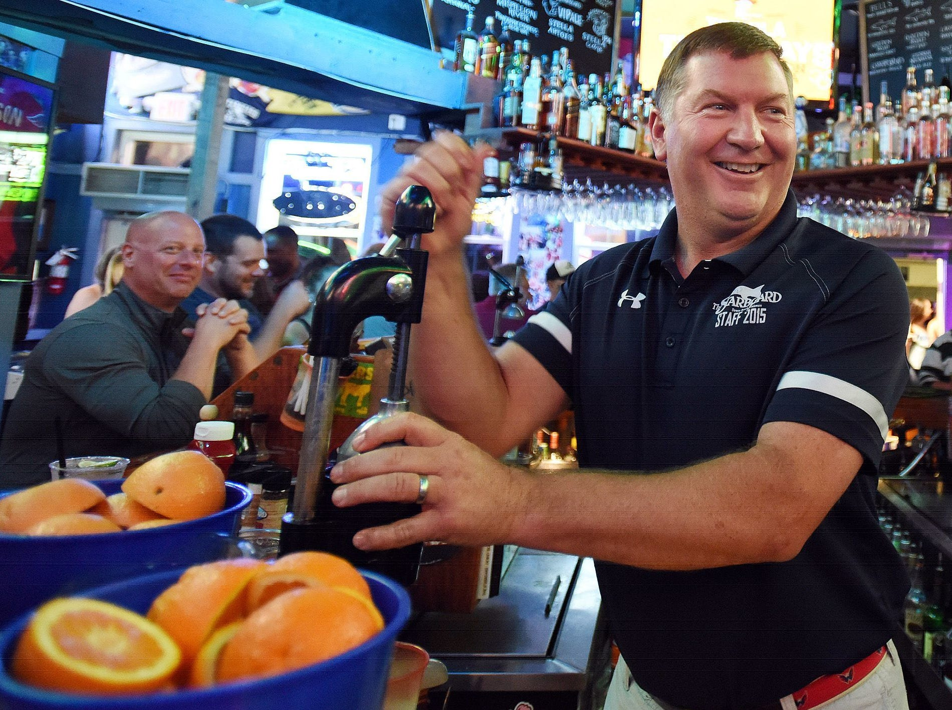 "Drink an Orange Crush at the Starboard in Dewey Beach. Here, co-owner Steve ""Monty"" Montgomery makes one. www.thestarboard.com"