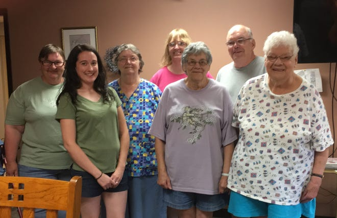 Becky Worden (second from the left) stands with residents from Acorn Apartments during Bingo Night on Tuesday, August 7, 2018.
