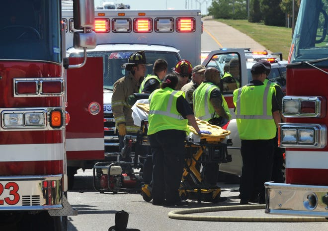 Wichita Falls police, fire, and emergency technicians work to free an accident victim from a  pin-in accident Monday afternoon.