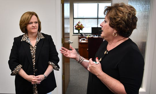 Leslie Schaffner, left, talks with Teresa Caves Monday morning at the Wichita Falls Area Community Foundation as she takes over the executive director position from Caves who is retiring after more than 15 years in the position.