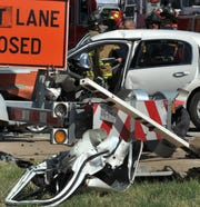 Wichita Falls police, fire, and emergency technicians work the scene of a pin-in accident on Kell Freeway eastbound, Monday afternoon.