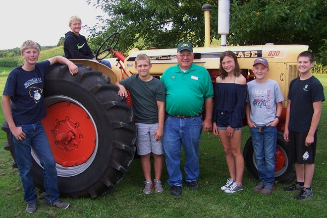 Winners of Tractor and Farm Safety camp scholarships awarded by the Lakeshore Two Cylinder Tractor Club gather for a group photo after the awards presentation at the club's annual picnic. From left, Dalen Meyers, Anthony Zucchi, Luke Zutz, Lakeshore club president Gerald Neuser of Mishicot, Alayna Litz, Matthew Fischer, and Isaac Pionek.
