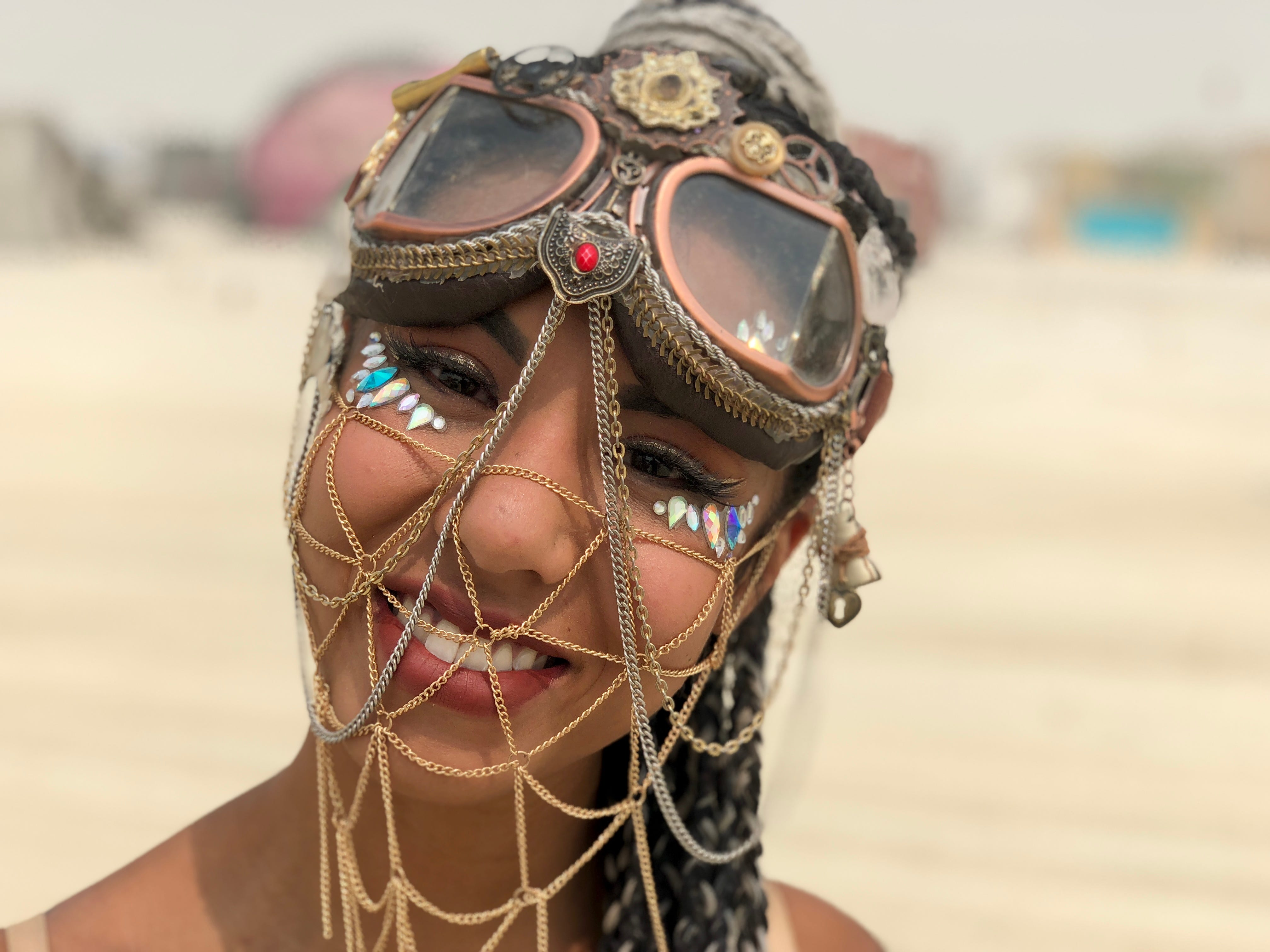Janet Ha of Austin, Texas, shows off her outfit at Burning Man during a pause between dust storms.