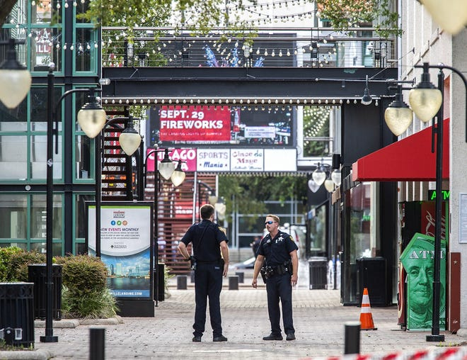 JACKSONVILLE, FL - AUGUST 26:  Jacksonville Sheriff's officers patrol around the ships at Jacksonville Landing on August 26, 2018 in Jacksonville, Florida. A shooting rampage during a Madden 19 video game tournament at the site claimed four lives, with several others wounded, according to published reports.  (Photo by Mark Wallheiser/Getty Images) ORG XMIT: 775215165 ORIG FILE ID: 1024158374