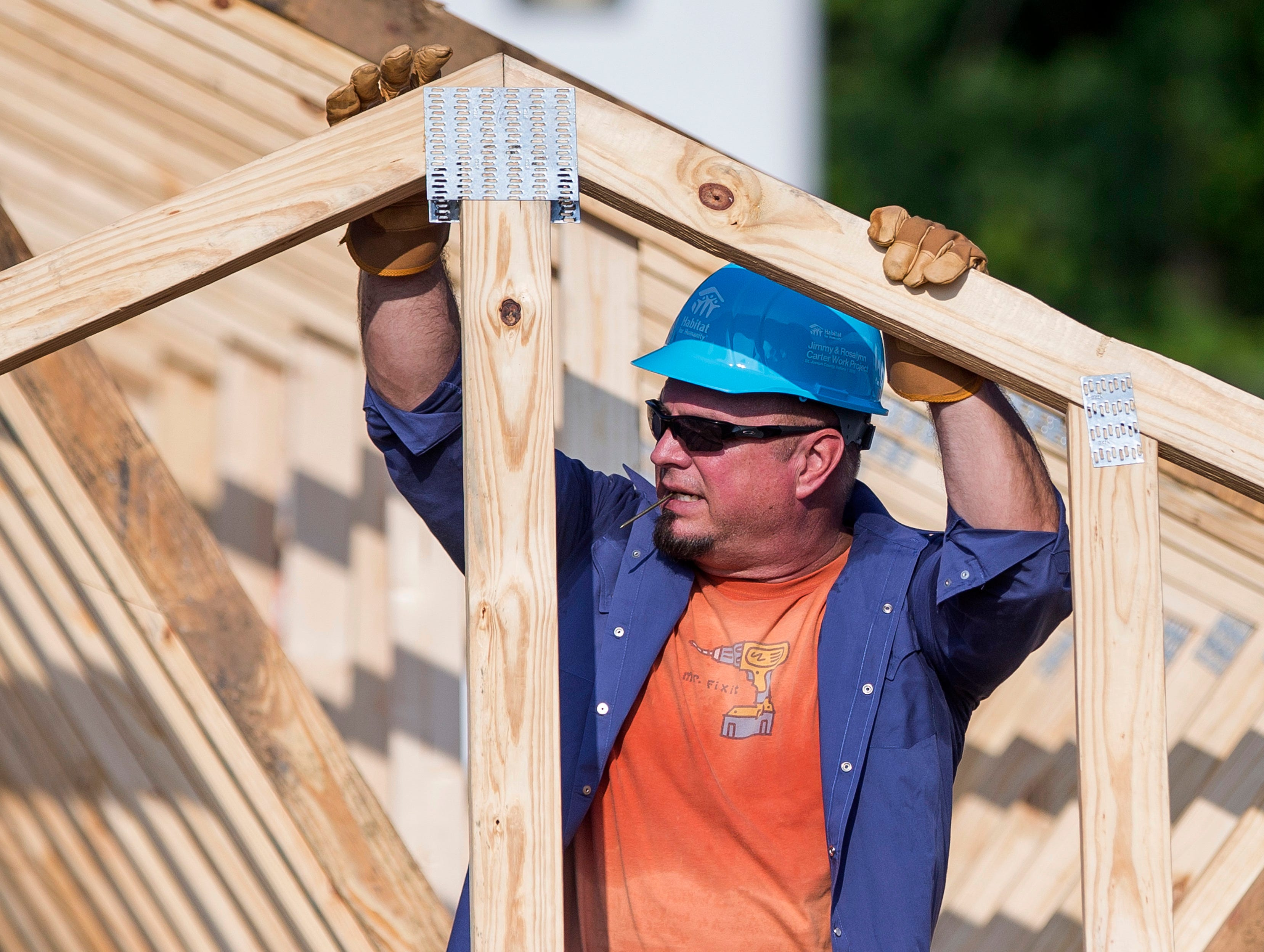 Country music star Garth Brooks works with other volunteers on site.