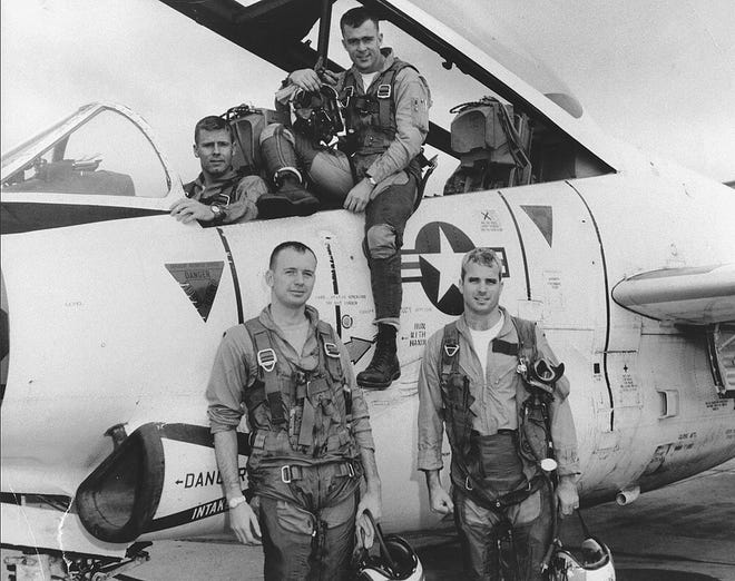 John McCain, right, with his Navy squadron in 1965.