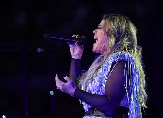 """You've got to just enjoy yourself and quit worrying if you're on top and people are digging you,"" Kelly Clarkson says. ""Today you might be cool, but tomorrow it will be somebody else."""