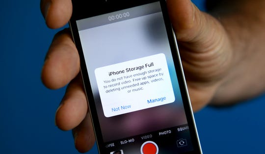"The dreaded ""Storage Full"" message on an Apple iPhone."