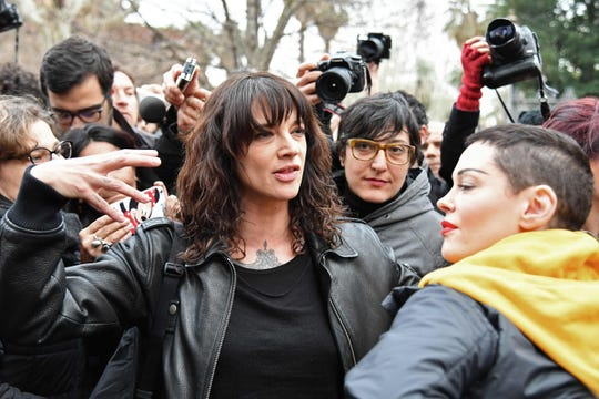 Asia Argento, center, with Rose McGowan, right, on March 8, 2018 during an International Women's Day march in Rome.