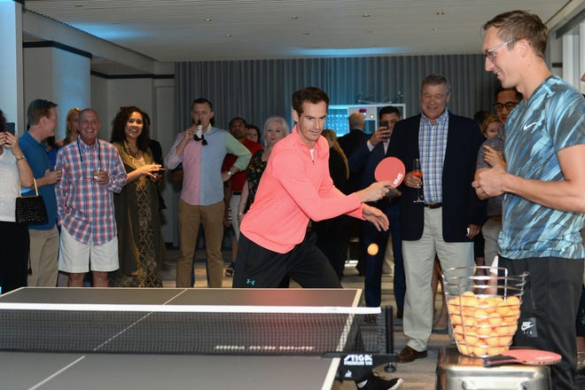 Tennis star Andy Murray plays ping pong at The Langham, New York, Fifth Avenue. Murray is in New York City for the U.S. Open.