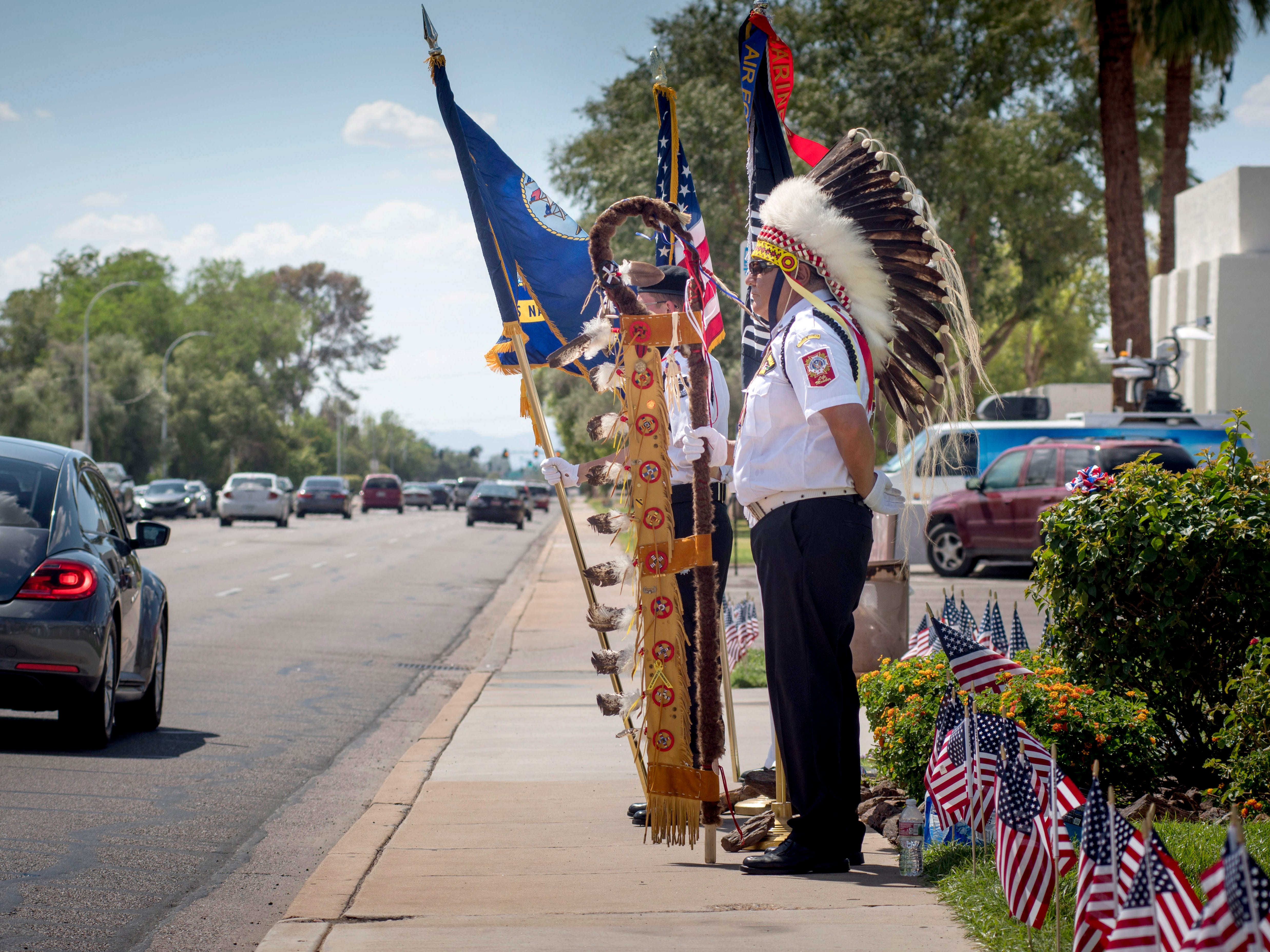 epa06975561 Richard Means, a member of the POW/MIA/KIA Honor Guard, as well as National American Indian Veterans, stands guard outside the mortuary where Senator John McCain was taken after his death from brain cancer, in Phoenix, Arizona, USA, 26 August, 2018. McCain's family announced on 24 August 2018 that he discontinued treatment for an aggressive brain cancer. McCain, a former Naval aviator, was shot down on a mission over Hanoi, in North Vietnam, in October 1967, and made a prisoner of war (POW) until 1973. He was the Republican nominee for President of the United States in the 2008 election, which he lost to Barack Obama. Menas is a member of the Cheyenne River Sioux Tribe of Eagle Butte, South Dakota.  EPA-EFE/RICK D'ELIA ORG XMIT: RDL