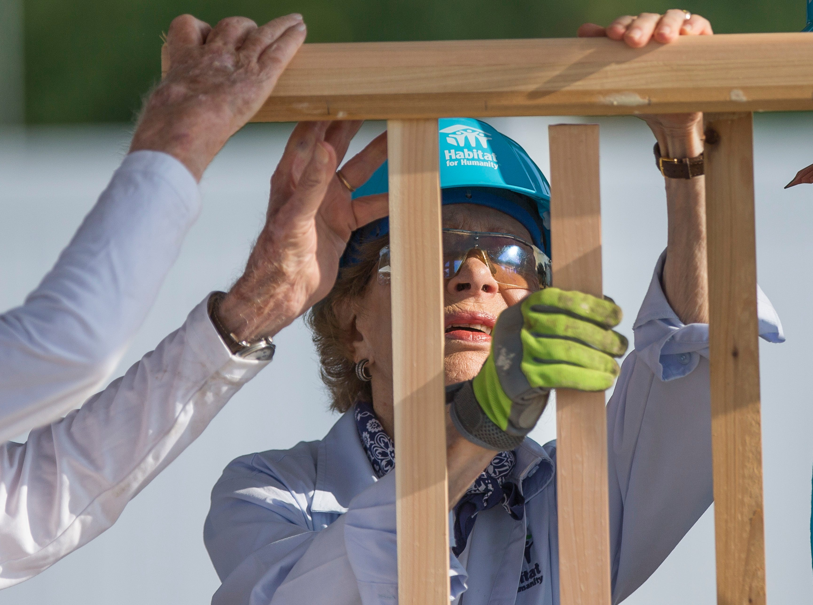 Former first lady Rosalynn Carter works with other volunteers on site during the first day of the weeklong Jimmy & Rosalynn Carter Work Project.