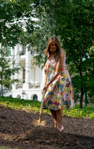 From left, First lady Melania Trump, accompanied by President James Monroe's fifth generation grandson Richard Emory Gatchell, Jr., and President Dwight Eisenhower's granddaughter Mary Jean Eisenhower, participate in a presidential tree planting ceremony on the South Lawn of the White House, Monday, Aug. 27, 2018, in Washington. The sapling was grown from the Eisenhower Oak and replaces a tree which blew down during a windstorm earlier this year. Additionally, this year marks the 200th anniversary of President Monroe's family moving back into the White House after the British set fire to it during the War of 1812. (AP Photo/Andrew Harnik) ORG XMIT: DCAH118