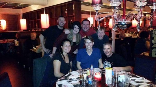 John Kilday, third from left in back, with his fiancée, second from left in back, and some of the friends he made through  gaming.