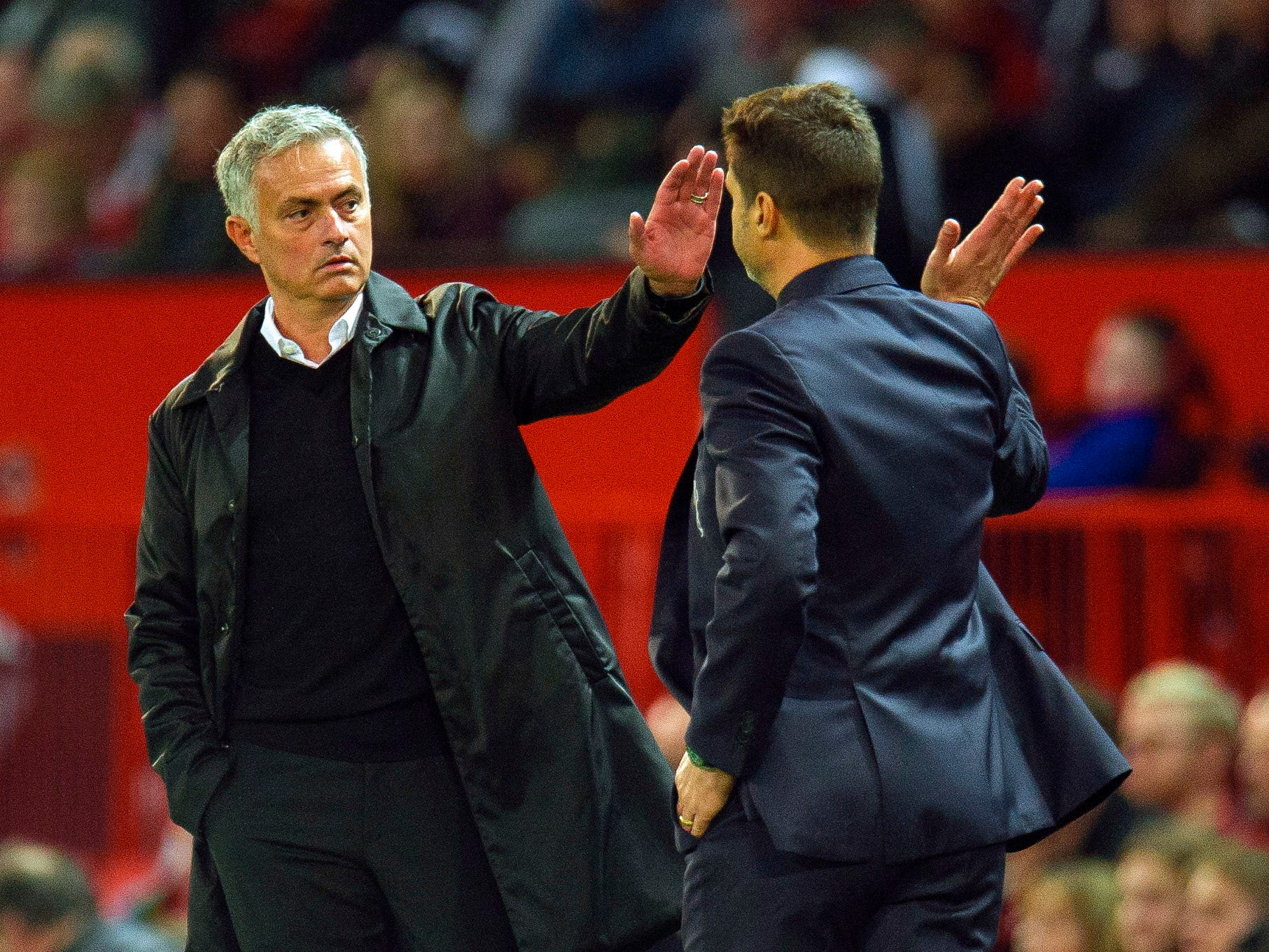 Manchester United manager Jose Mourinho (left) gives Tottenham Hotspur manager Mauricio Pochettino a high five during Tottenham's 3-0 win at Old Trafford.