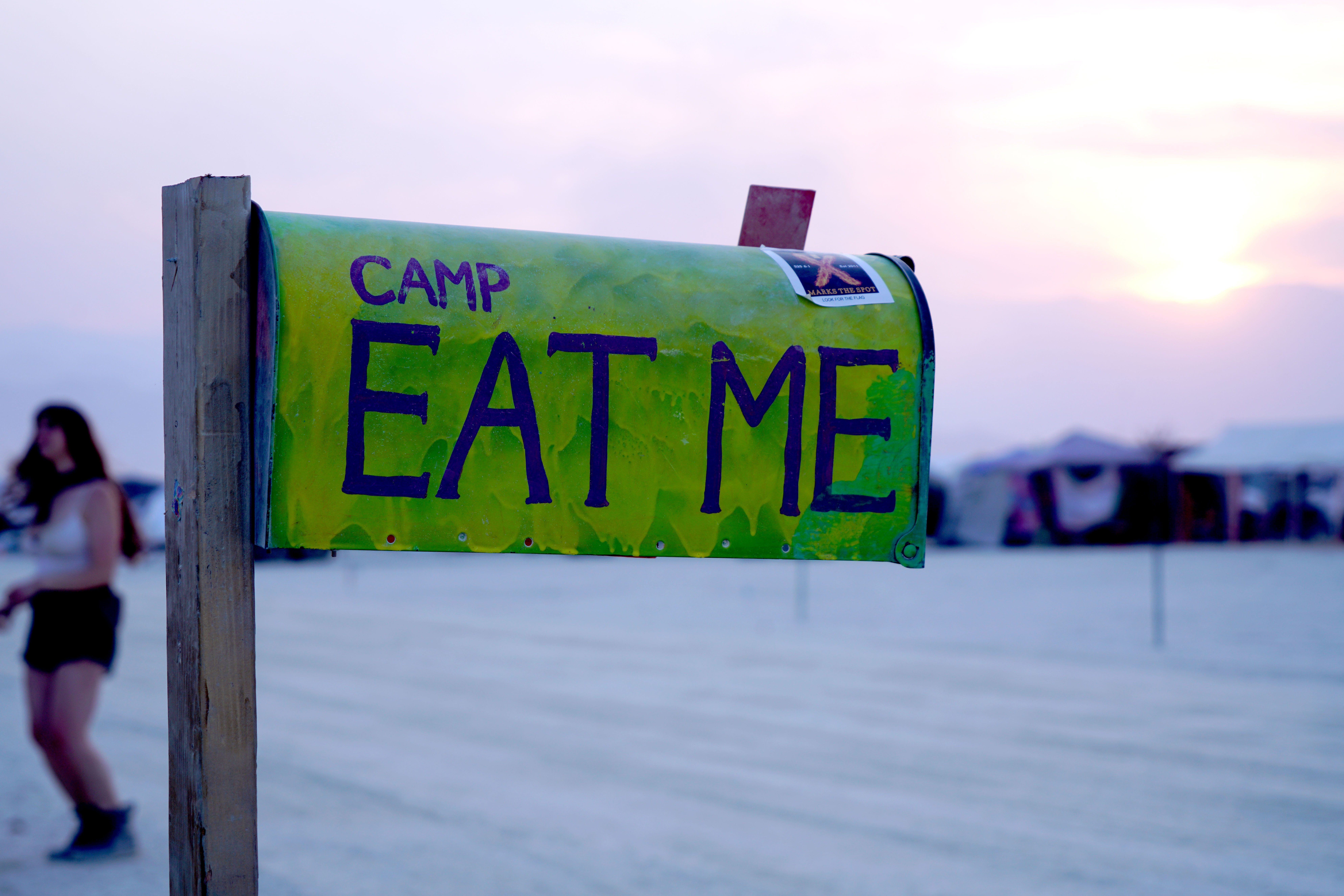 """Attendees at Burning Man give their camps whimsical names. Camp Eat Me specializes in """"awful"""" food, such as waffles topped with dried bugs."""