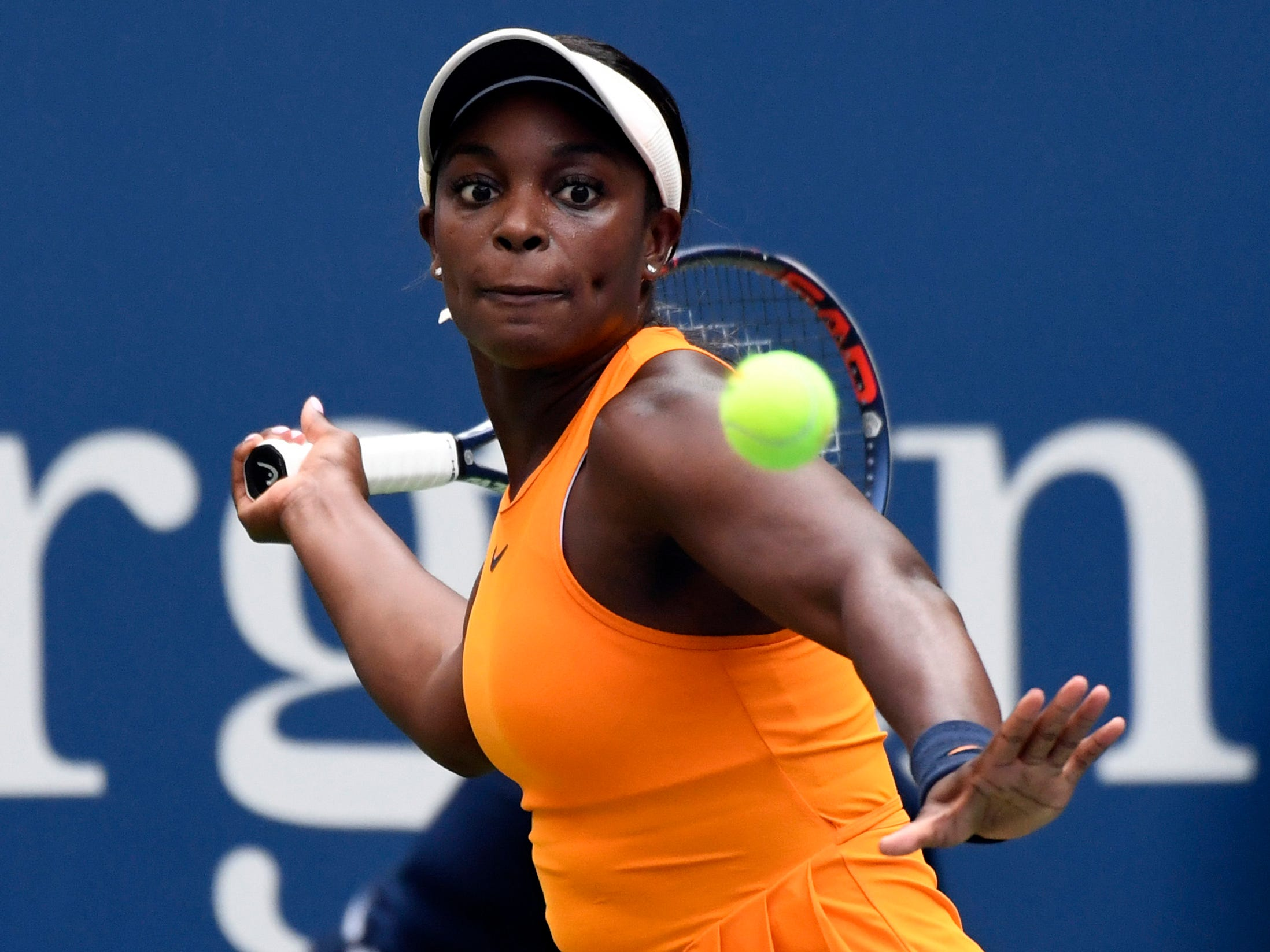 Defending champion Sloane Stephens of the USA lines up a forehand during her 6-1, 7-5 victory against Evgeniya Rodina of Russia to open defense of her title.