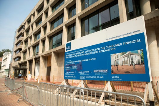 A sign stands at the construction site for the Consumer Financial Protection Bureau's new headquarters in Washington, Monday, Aug. 27, 2018. Seth Frotman, the nation's top government official overseeing the $1.5 trillion student loan market resigned on Monday, citing what he says is the White House's open hostility toward protecting student loan borrowers. Frotman is the latest high-level departure from the CFPB since Mick Mulvaney took over in late November. (AP Photo/Andrew Harnik) ORG XMIT: DCAH104