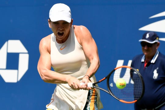 Simona Halep of Romania hits to Kaia Kanepi (not pictured) of Estonia during the first round of the 2018 U.S. Open tennis tournament at USTA Billie Jean King National Tennis Center.